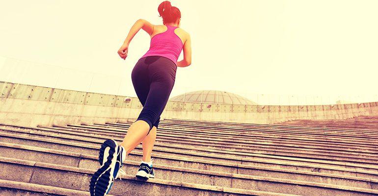 Runner athlete running on escalator stairs. woman fitness joggin